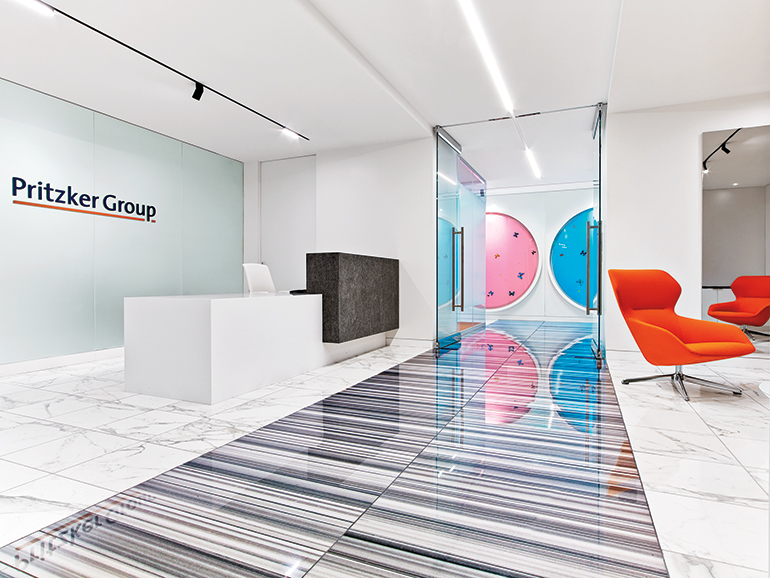 Bright colors and contemporary artwork punctuate pritzker for Office design publications