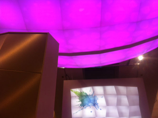 The lobby cloud in Cellular Resin, lensed with a stones pattern and comprising 24 boxes of color-changing LEDs.