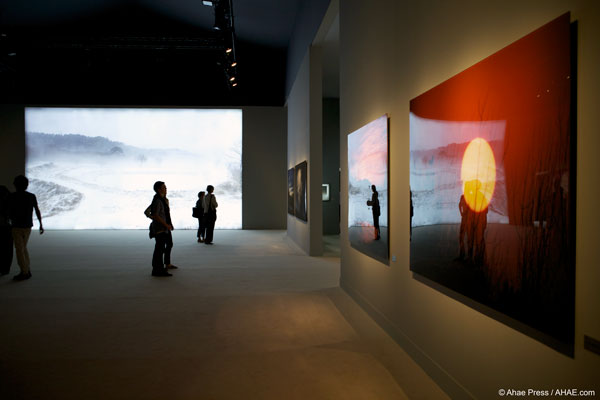 The center room in the pavilion is dominated by two massive LED-illuminated photographs. Photo courtesy of Ahae Press.