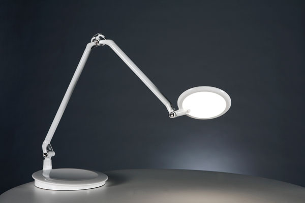 Designed by Peter Stathis and Michael McCoy, Humanscale's Element Disk was the first task light to use thin-film LED technology. The combination of high-intensity micro LEDs and layers of polycarbonate and optical films create a lamp with less glare and a wide footprint.