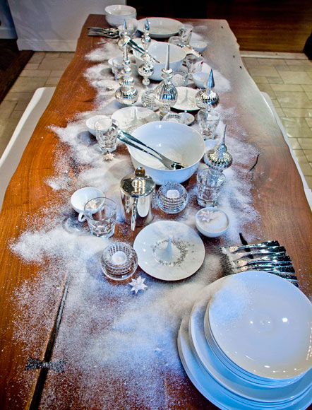 The table in Nancy J. Ruddy's vignette was decorated with white Bernardaud plates and Baccarat crystal pieces.