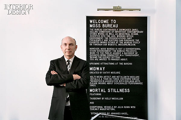 The CEO Of Moss Bureau Next To The Company Mission Statement